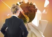 Составное изображение бизнесвумен, стоя с руки на бедрах — Стоковое фото