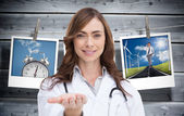 Female nurse holding out open palm — Stock Photo