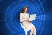 Businesswoman sitting and using laptop — Stock Photo