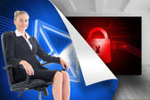Businesswoman sitting on swivel chair in black suit — Stock Photo