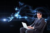 Businessman sitting on an armchair work — Stock Photo