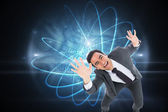 Composite image of excited businessman with arms raised — Stock Photo