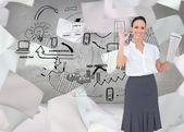 Businesswoman making gesture while holding newspaper — Stock Photo