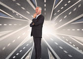 Composite image of businessman looking away — Stock Photo