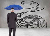 Composite image of businessman holding umbrella — Foto Stock