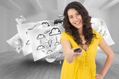 Composite image of smiling curly haired pretty woman changing channel — Stock Photo