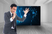 Composite image of excited businessman catching — Stock Photo