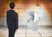 Composite image of businessman turning his back to camera — Stock Photo