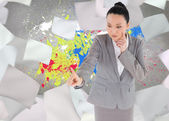 Unsmiling thinking asian businesswoman pointing — Stock Photo