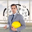 Serious architect holding plans and hard hat — Stock Photo #38510407