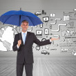 Peaceful businessmholding blue umbrella — Stock Photo #38511111