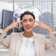 Composite image of confident young businesswoman pointing her head with her fingers — Stock Photo