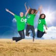 Stock Photo: Three enviromental activists jumping and smiling