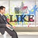 Composite image of businessman using laptop — Stock Photo #38517031