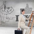 Businesswoman climbing career ladder with briefcase — Stock Photo