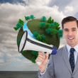 Stock Photo: Smiling businessman holding a megaphone