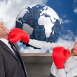 Stock Photo: Composite image of businesswoman hitting colleague with her boxi