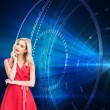 Composite image of thoughtful blonde wearing red dress — Stock Photo