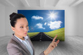 Composite image of unsmiling asian businesswoman pointing — Foto Stock