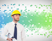 Architect posing with hard hat and plan — Stock Photo