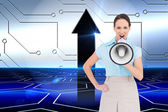 Composite image of furious classy businesswoman talking in megaphon — Stock Photo