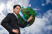 Composite image of unsmiling asian businessman pointing — Foto Stock