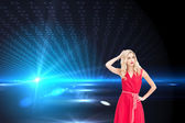 Composite image of elegant blonde standing hand on hip — Stock Photo