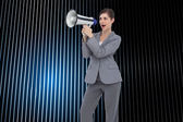 Composite image of businesswoman with loudspeaker — Photo