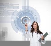 Smiling doctor pointing — Stock Photo