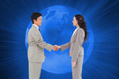 Side view of hand shaking trading partners — Stock Photo