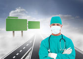 Composite image of portrait of an ambitious surgeon — Stock Photo