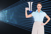 Composite image of stern classy businesswoman holding megaphone — Stock Photo