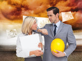Architects with plans and hard hat — Stock Photo