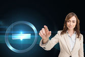 Composite image of portrait of businesswoman touching invisible screen — Stock Photo