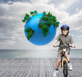 Little boy with his bike in a park — Stock Photo