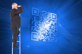 Composite image of mature businessman standing on ladder — Stock Photo