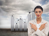 Businesswoman with her arms crossed and fingers pointing — Stock Photo