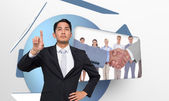 Unsmiling asian businessman pointing — Stock Photo