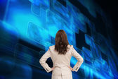 Composite image of businesswoman standing back to camera — Stock Photo