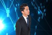 Composite image of serious asian businessman — Stock fotografie