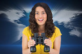 Woman holding binoculars — Stock Photo