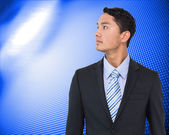 Composite image of serious asian businessman — Stock Photo