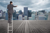 Composite image of businessman standing on ladder — Stock Photo