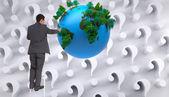 Samengestelde afbeelding van zakenman permanent op ladder — Stockfoto