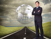 Businessman standing cross-armed — Stock Photo