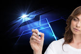 Composite image of concentrated businesswoman holding whiteboard — Stock Photo