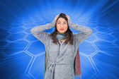 Composite image of anxious pretty brunette wearing winter clothes — Stock Photo