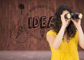 Young woman using binoculars — Stock Photo