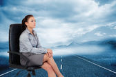 Serious businesswoman sitting on armchair — Stock Photo