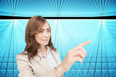 Composite image of businesswoman pressing an invisible key — Stock Photo
